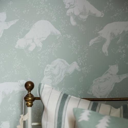 Nærbilde av grønn tatpet med isbjørner på i et barnerom